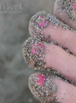 Pink toes in sand