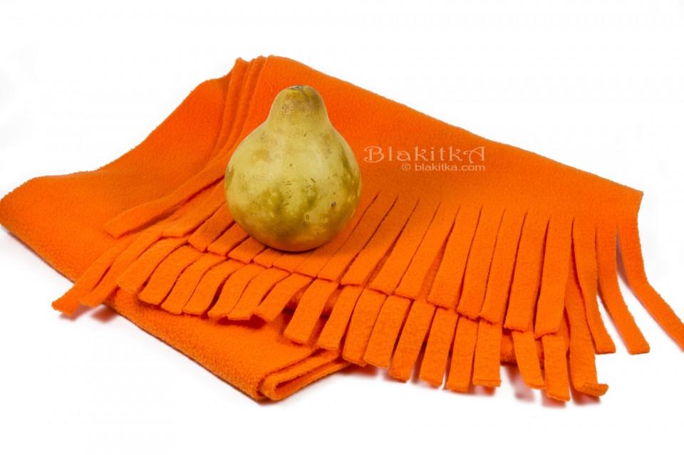 decorative squash on orange scarf