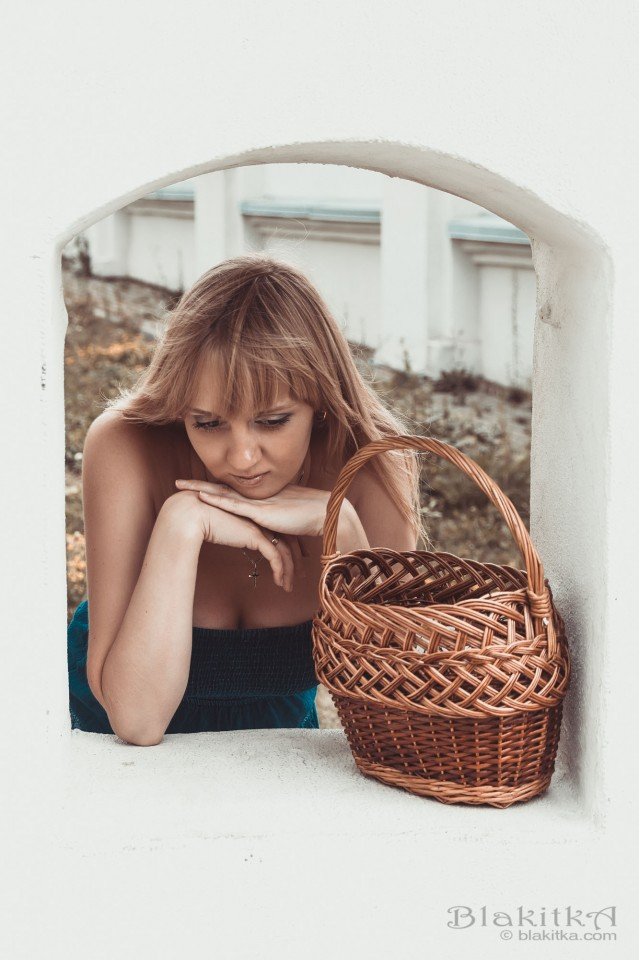 Girl with the basket in a little window