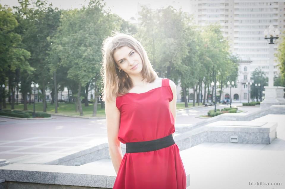 Girl in red in sunshine