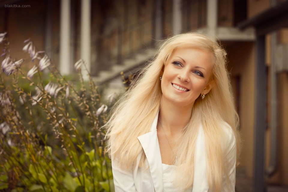 Happy young woman with waving blonde haires