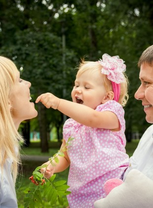 Happy little girl and her parents
