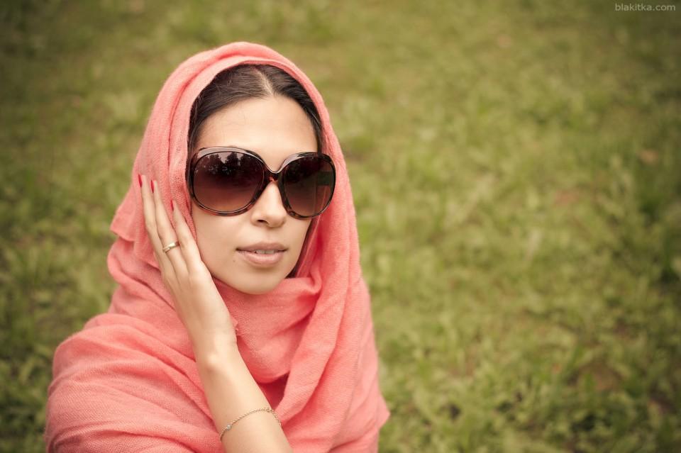 Beautiful arabian girl in shawl and sun glasses.
