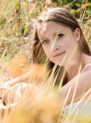 blonde girl in grass