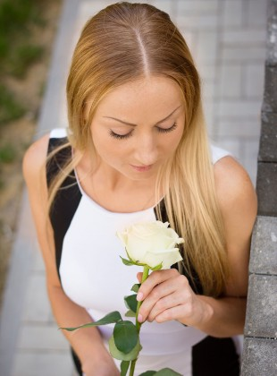 Blonde girl and white rose