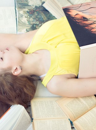 Girl in a yellow dress among books
